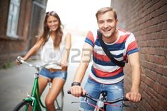 Portrait of happy young couple on bicycles Stock Photo