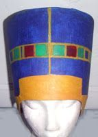Scrapgowns: Nefertiti Headpiece  The hat consists of a large white (ice cream) bucket and top, paper, oil and acrylic paint, cardboard, glue and tape. ::  Why be Cleopatra when you can be Nefertiti?