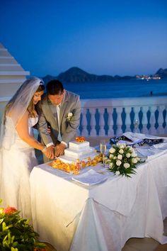 Orange and White Destination Wedding in Cabo - Riu Palace Cabo San Lucas Wedding - Wedding cake - Bride and groom