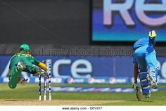 Cardiff, Wales,UK. 6th June, 2013. South Africa's AB de Villiers attempts to run out India's Dinesh Karthik during the ICC Champions Trophy international cricket match between India and South Africa at Cardiff Wales Stadium on June 06, 2013 in Cardiff, Wales. (Photo by Mitchell Gunn/ESPA/Alamy Live News) - Stock Image