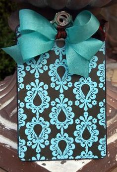 DIY idea ~ use wrapping paper and mod podge it to a clipboard. Seal it with appropriate sealer. Make a beautiful bow and hot glue it on.   Fabric can also be used with heat sealer or appropriate glue. by Mary Ann1433
