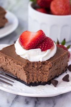 These chocolate cheesecake bars are the smoothest, creamiest chocolate cheesecake recipe out there. Then with an oreo crust, whipped cream & berries - go wrong with this easy cheesecake recipe