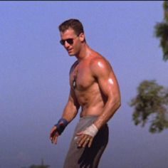 """An image ingrained in most women's memories from the 1986 movie, """"Top Gun"""": Slider (actor Rick Rossovich) striking his pose during the volleyball match... This is my favorite scene in the movie!!-Espy"""