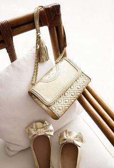 Ladylike quilting and chains: the link to a pulled-together look. Our Fleming Metallic Small Convertible Shoulder Bag is made of gold crinkled leather detailed with an embossed logo, a unique diamond