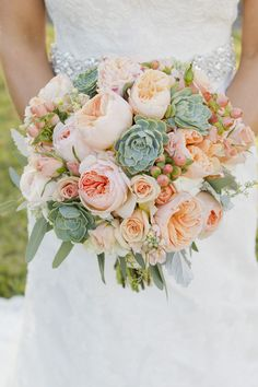 Bouquet by Twigs Floral Design. Peach Juliet garden roses with succulents bouquet.