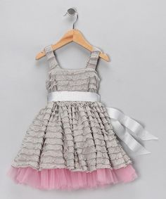 Preruffled fabric combined with tulle underskirt & a satin ribbon sash -- cute for special occasions
