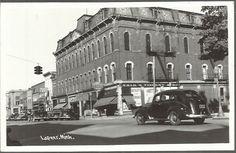 RPPC 1940'S STREET SCENE OF HARDWARE & DRUG STORE, CAFE IN LAPEER, MICHIGAN