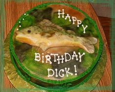 """Fish - This was a joke for a guy who said that his perfect woman would wear camo and hold fish.  LOL  The fish is made from candy clay and airbrushed.  Camo is also airbrushed.  He said the cake was """"beautiful"""".  Well.....I would not go that far!"""