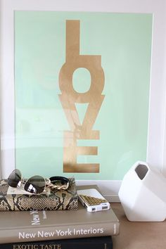 """""""Add a little bit of love to a bedroom, bath, kitchen, or even living-room wall!"""" MadeByGirl LOVE Metallic Gold On Mint"""