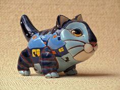 Ceramic cat figurine by Anya Stasenko and Slava Leontiev