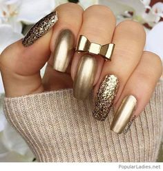 Amazing gold manicure with glitter