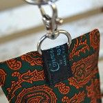 Upcyled retro necktie Phone pouch with removeable wristlet. green orange paisley - by UrbanTreehouse on madeit