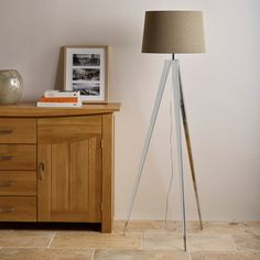 Metal tripod floor lamp with brown linen cylindrical shade. Spend £1,500 and get it free. Shop online now. Free delivery.