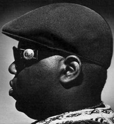 The Notorious B.I.G. aka Biggie Smalls (born Christopher Wallace), rap legend. He became a central figure in the East Coast vs. West Coast beef with 2Pac, and was noted for his loose, easy flow, semi-autobiographical lyrics & storytelling abilities that covered the range of mafioso, braggadocio, drug dealing, romance & humor. One of the best artists in rap music, The Source ranked him #3 on their list of the Top 50 Lyricists of All Time. He has sold over 17M units worldwide. R.I.P.