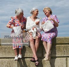 Women Eating Lunch on Brick Wall