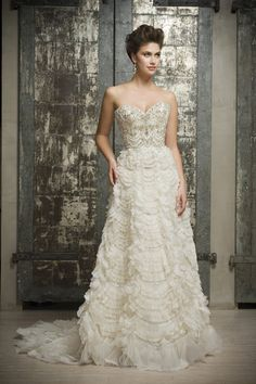 <strong class='info-row'>Enaura Bridal</strong> <div class='info-row description'>Style ES516   Strapless sweetheart neckline, fully beaded bodice, natural waist, scalloped ruffled ball gown skirt</div> <div class='row info-row text-center'> <div class='col-xs-6 col-xs-offset-3'> <a class='image-caption-view-website' href='http://www.enaurabridal.com/product/es516/' rel='nofollow' target='_blank'> <div class='view-website'>View Website</div> </a> </div> </div>
