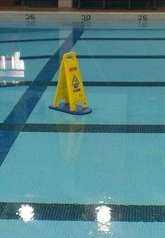 Caution wet floor pool