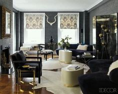 grasscloth walls ikat roman shades and that black upholstered armchair