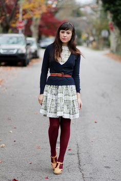 Belted sweater over dress