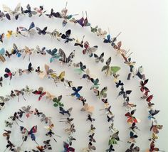 This wall display looks stunning, with butterflies made from recycling magazines! #thrifty #papercrafterpick