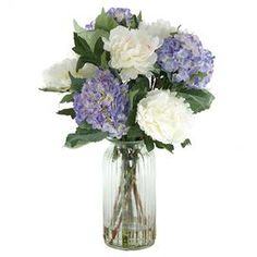 """Buy some flowers at the craft department... make my own. Faux blue hydrangea and white peony arrangement in a glass vase. Made in the USA.  Product: Faux floral arrangementConstruction Material: Silk and glassColor: Blue and whiteFeatures: Made in the USADimensions: 25.5"""" H x 20"""" Diameter"""
