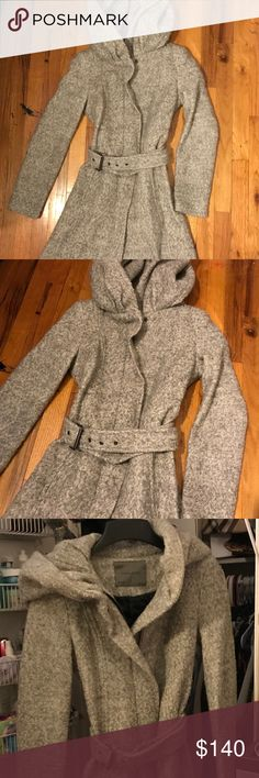 Zara Wool Coat Very Warm Zara Wool Coat with hood and belt. Very Classy. Can Pair with any outfit and still feel cozy. Brand New with no Tag. Pet and Smoke Free Home.  Length is 30.5 inches from shoulder Width is 18 inches from armpit to armpit Zara Jackets & Coats