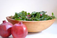Healthy and light gluten-free and vegan pomegranate salad featuring just 4 ingredients: arugula, pomegranate seeds, olive oil and balsamic vinegar.