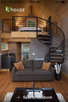 Love the colors and shapes with the wood and iron details. Loft space allows for a studio apartment self contained.
