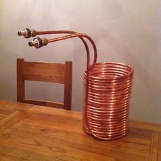 """My hand wound wort chiller. 18m of 1/2"""" copper tube. Wound around a 19L soda keg. Compression fittings. Heavy duty plumbers tape (pink).   Cooled my first brew from 75*C to 25*C in about 20mins."""