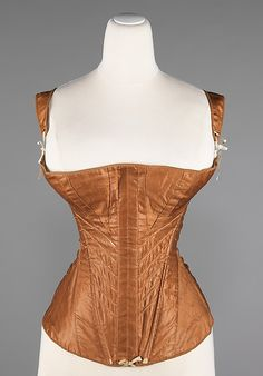 Corset 1830, American, Made of cotton ~~~~~ After 1820 as the neat slim waist emerged, corsets were worn again by all women.