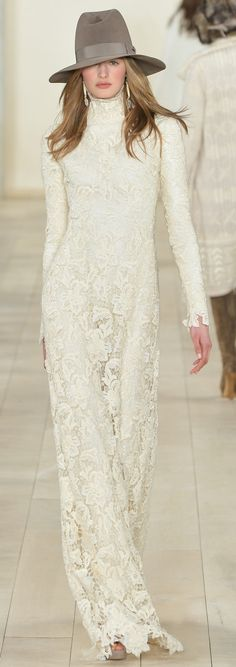 A white floral lace evening dress walks the runway at the Ralph Lauren Collection Fall 2015 Ready-to-Wear
