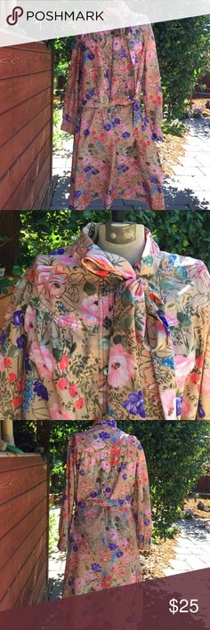 """•VTG• Floral Dress Beautiful Vintage Condition! Tag is removed and instruction tag very faded. No other damage snags or missing buttons. Pretty Shell like buttons. Tie and neck and belt at waist. One pocket. Size Med-Large. Feels like a silky polyester. This unique Estate Sale Find came from a smoke free closet. My home is also smoke and pet free. ✨❤️✨ Measurements: Bust 23"""" Length 43"""".  Vintage Dresses"""