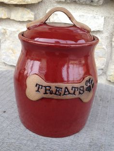 Dog treat jar handmade on pottery wheel. Imagine this cute little pet treat jar sitting on your counter top waiting to reward your pup! This
