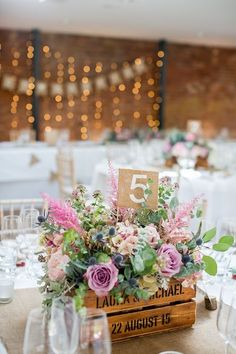 rustic pink flowers wood box wedding centerpiece / http://www.deerpearlflowers.com/rustic-wedding-details-and-ideas/