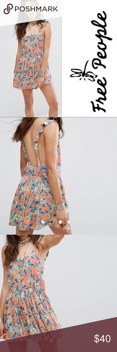 Free People Dear You Mini Dress NWT Free People Dear You Mini Dress in Orange. The dress features a Floral design, scoop neck, ruffle straps, and a low scoop back. 100% Rayon. Machine Washable. TTS. Free People Dresses Mini