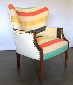 Art Deco wing back chair with Pendleton style striped upholstery and brass nail head trim from MODERNHAUS --- even though it's probably too itchy most of the time because of the felted wool, I ADORE how this looks. Upholstery Fabric For Chairs, Chair Fabric, Wingback Chairs, Velvet Chairs, Upholstery Repair, Upholstery Tacks, Upholstery Cleaning, Pink Chairs, Black Chairs