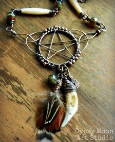 Feather And Tooth Necklace | ... Copper Wire Wrapped Pentacle Pentagram with Tooth, Bone, and Feathers