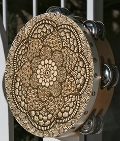 Henna Mandala Tambourine with intricate details. $45.00, via Etsy.