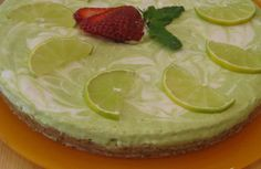 Key Lime Pie with Almond, Macadamia + Date Crust  (Filling made with zucchini, coconut meat, coconut nectar, coconut oil Crust made with Almond, macadamia, dry coconut, dates, coconut oil)