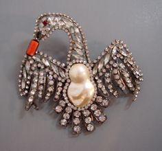 VRBA     swan brooch with baroque artificial pearl body, coral beak and clear  rhinestones set in antiqued silver tone, 5.