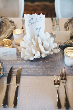 Beach wedding table number- love the use of coral | Romantic & Natural Beach Wedding Ideas via TheELD.com