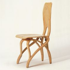 "Sedia Per La Casa Cattaneo Agra  Design: 1953  Manufacturer: Apelli & Varesio, Turin, Italy  Material: bent plywood, brass  Carlo Mollino designed a chair duo, ""male"" and ""female,"" as part of the furniture for the house owned by L. Cattaneo in Luino, also built by Mollino between 1952-3.  The distinguishing feature of the matching chairs for Casa Cattaneo is that the seat, back, and legs are all made of plywood"