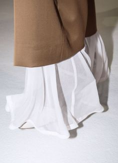 Flowy white skirt and oversized camel colored sweater