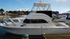 Caribbean 32 Flybridge Cruiser - New & Used Boats, St Kilda Boat Sales Melbourne Windbreak and cockpit awning made by Canvas Barn Marine Trimming