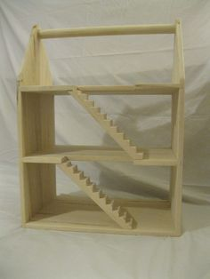 Wooden Doll House. $150.00, via Etsy.  So simple! It leaves tons of room for a child's imagination :)