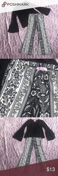 """GIRLS! Like new! Black & White Bell Bottom Pants. These adorable girls Bell bottom pants will Make any girl smile! They have a comfortable elastic waist, stretch material and a 24 1/4"""" inseam. Brand is i💗pinc and these were only worn twice.  The blouse is also available in my closet as a delegate listing! Create a bundle and you'll get an automatic 10% discount! Or feel free to make a reasonable offer! i💗pinc Bottoms Casual"""