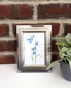 An A6 print of a watercolour bluebell Beautiful for decoration or for sending to a friend! ♥ Ive left the back of the postcard mainly blank, if you want to write your own personal message, except for my name written at the bottom. The bluebell print is made with quality 250gsm card Dimensions of the bluebell print are: Height: 15cm Width: 10.5cm (Approx A6) The A6 bluebell print is sent in a cellophane pocket, in a brown envelope, first class stamp, with a card backing inside the envel... Tree Illustration, Botanical Illustration, First Class Stamp, Blue Crafts, Postcard Printing, Brown Envelopes, Blue Gift, Blue Painting, Framed Prints