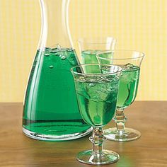 Green Wine Spritzers - I bought lime seltzer by accident - now I have a yummy use for it! :)  Place 1 drop of green food coloring into each of 8 wine glasses (or 8 drops in a large pitcher).  Divide 1 chilled 750ml bottle of dry white wine among glasses, or pour into pitcher.  Top with 1 liter chilled plain or lime-flavored seltzer; stir lightly. Serve promptly. Serves 8.