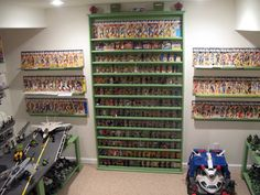 A toy garage is a simple structure to store and display collected toys. Toy garages can be played with the purpose of toy collecting these items is display. Toy Display, Display Case, Action Figure Display, Action Figures, Gi Joe, Toy Garage, Modern Toys, Geek Decor, Toy Rooms