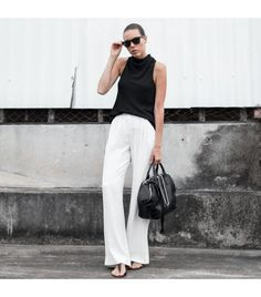@Who What Wear - Modernlegacy is wearing: Camilla and Marc tank top, Sass & Bide pants, Alexander Wang shoulder bag, ATP sandals, Ray-Ban sunglasses.  Get The Look:  Classiques Entier Papyrus Weave Wide Leg Trousers ($188) in Cream Cloud  See more ways to wear white pants on Pose.com.